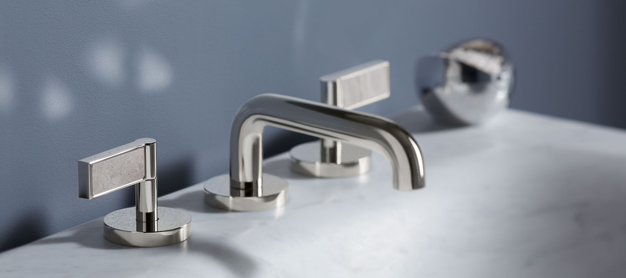 One decorative collection in collaboration with andre for Kallista bathroom faucets